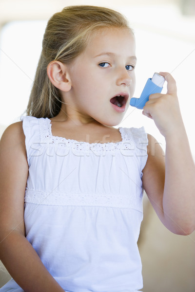 Girl Using An Inhaler Stock photo © monkey_business