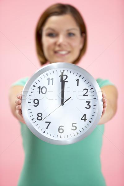 Mulher relógio 12 sorrir Foto stock © monkey_business