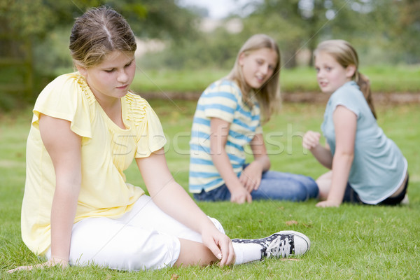 Two young girls bullying other young girl outdoors Stock photo © monkey_business