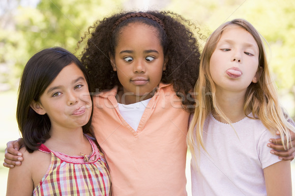 Three young girl friends outdoors making funny faces Stock photo © monkey_business