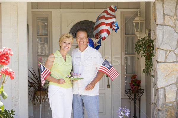 Couple at front door on fourth of July with flags and cookies sm Stock photo © monkey_business