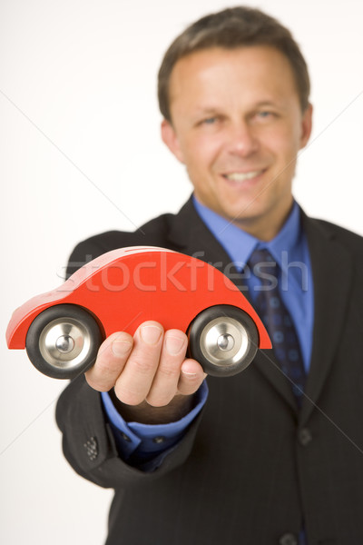 Businessman Holding A Toy Car  Stock photo © monkey_business