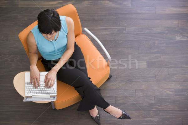 Kobieta interesu posiedzenia laptop człowiek ludzi biznesu Zdjęcia stock © monkey_business