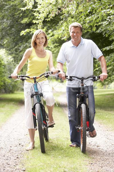 Coppia equitazione bikes campagna sorriso uomo Foto d'archivio © monkey_business