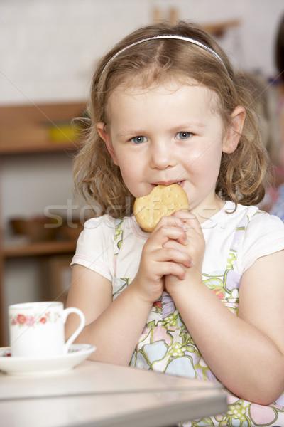 Stock photo: Young Girl Having Tea at Montessori/Pre-School