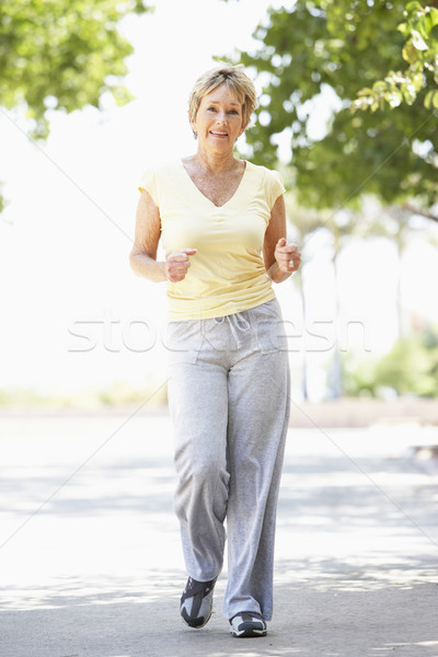 Stock photo: Senior Woman Jogging In Park