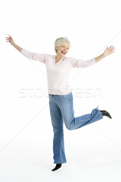 Full Length Studio Portrait Of Smiling Senior Woman Stock photo © monkey_business