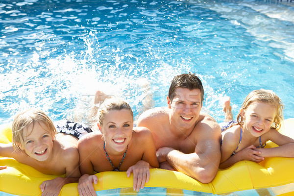 Young family having fun together in pool Stock photo © monkey_business