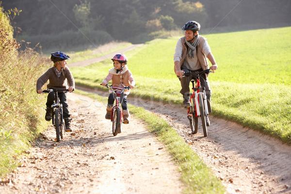 Photo stock: Jeunes · père · enfants · vélos · parc · fille