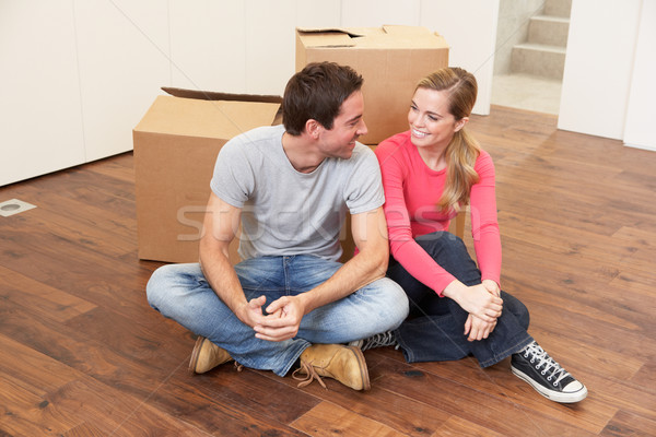 Young couple on moving day sitting with cardboard boxes Stock photo © monkey_business