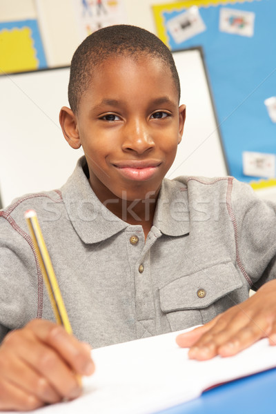 Schoolboy Studying In Classroom Stock photo © monkey_business