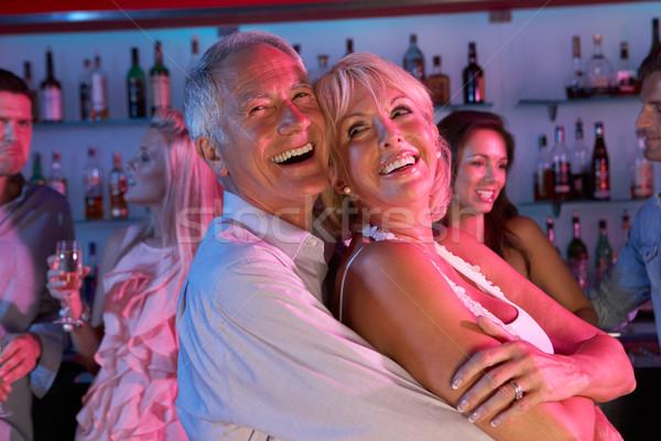 Idős pár szórakozás elfoglalt bár nő tánc Stock fotó © monkey_business
