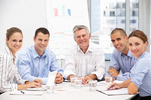 Colleghi incontro di lavoro computer ufficio donne riunione Foto d'archivio © monkey_business