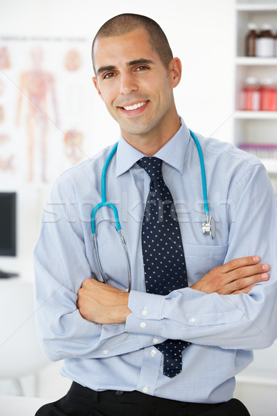 Young male doctor in consulting room Stock photo © monkey_business