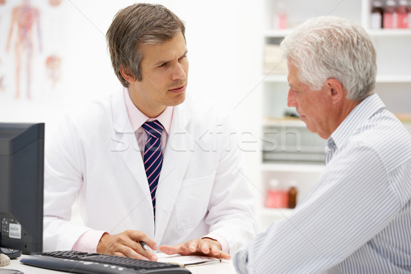 Doctor with senior patient Stock photo © monkey_business