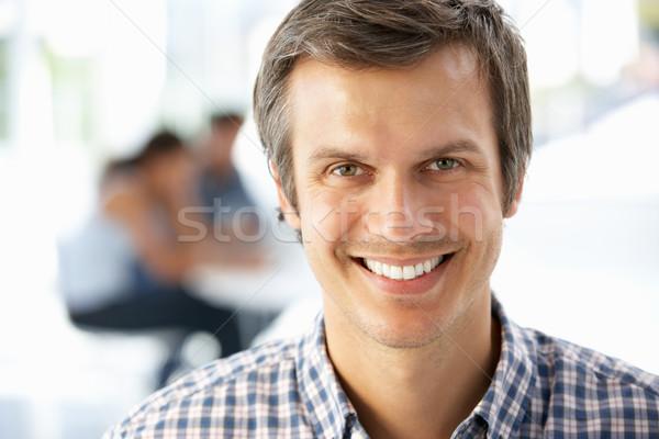 Imprenditore ufficio lavoro abito sorridere maschio Foto d'archivio © monkey_business