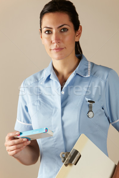 UK nurse holding prescription drug pack Stock photo © monkey_business