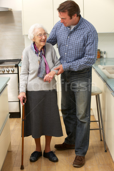 Mother and adult son in kitchen Stock photo © monkey_business