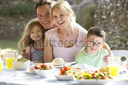 Family on vacation eating outdoors Stock photo © monkey_business