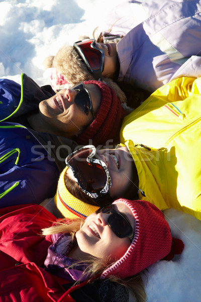 Overhead View Of Teenage Family Lying In Snow On Ski Holiday In  Stock photo © monkey_business