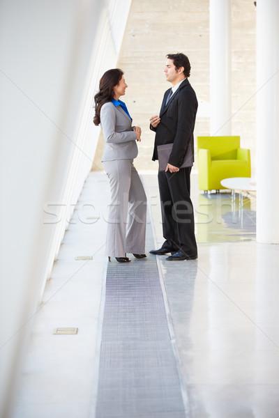Businessman And Businesswomen Talking In Modern Office Stock photo © monkey_business