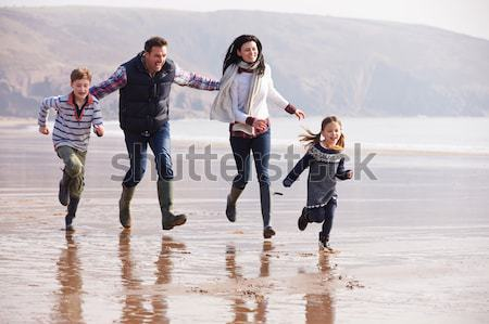 Multi Generation Family Having Fun On Beach Holiday Stock photo © monkey_business