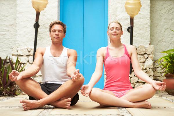 Couple Meditating Outdoors At Health Spa Stock photo © monkey_business