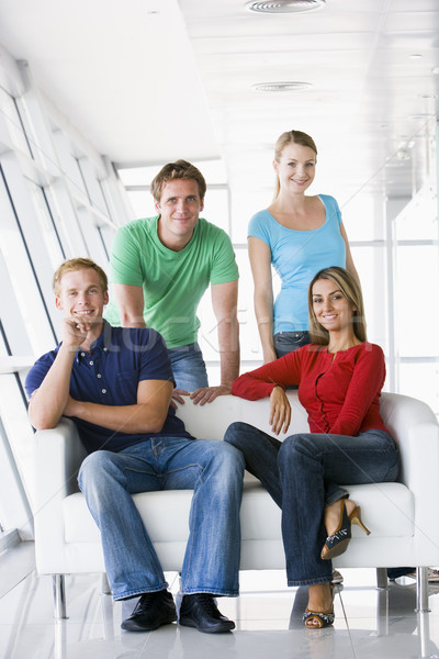 Four people in lobby smiling Stock photo © monkey_business