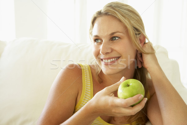 Mid Adult Woman Eating A Healthy Apple Stock photo © monkey_business