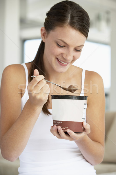 Young Woman Eating Chocolate Ice-Cream Stock photo © monkey_business