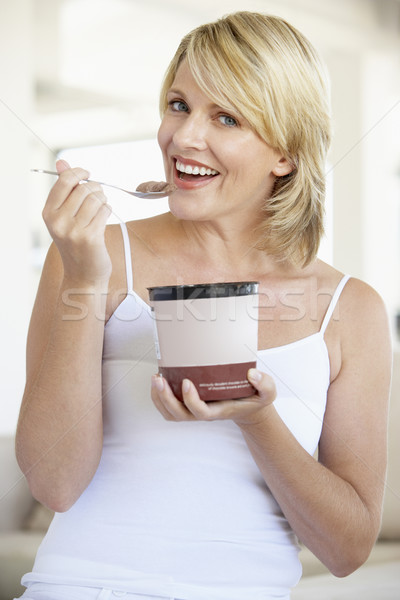 Mid Adult Woman Eating Chocolate Ice-Cream And Smiling At The Ca Stock photo © monkey_business