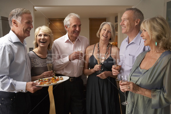 Man Serving Hors D'oeuvres To His Guests At A Dinner Party Stock photo © monkey_business
