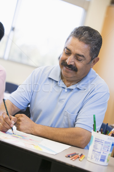Mature male student in art class Stock photo © monkey_business