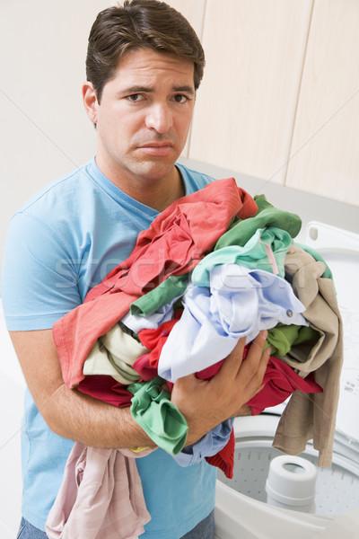 Stock photo: Man Upset Doing Laundry
