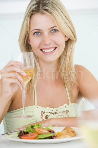 Young Woman Enjoying meal,mealtime With A Glass Of Wine Stock photo © monkey_business