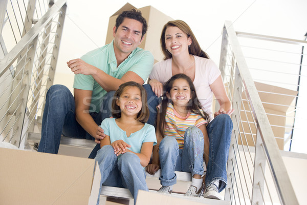 Сток-фото: семьи · сидят · лестница · коробки · новый · дом · улыбаясь