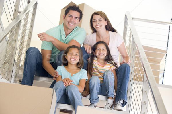 Familia sesión escalera cajas nuevo hogar sonriendo Foto stock © monkey_business