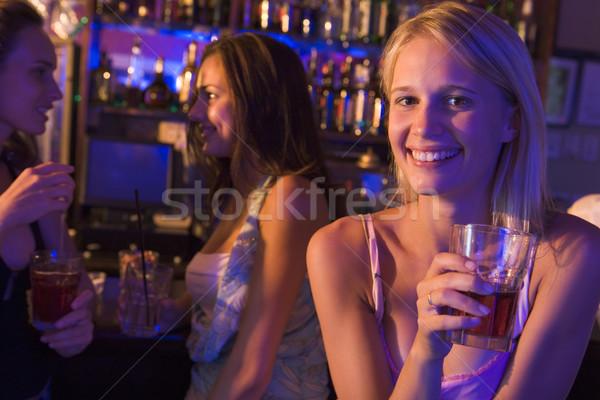 Three young women enjoying drinks at a nightclub Stock photo © monkey_business