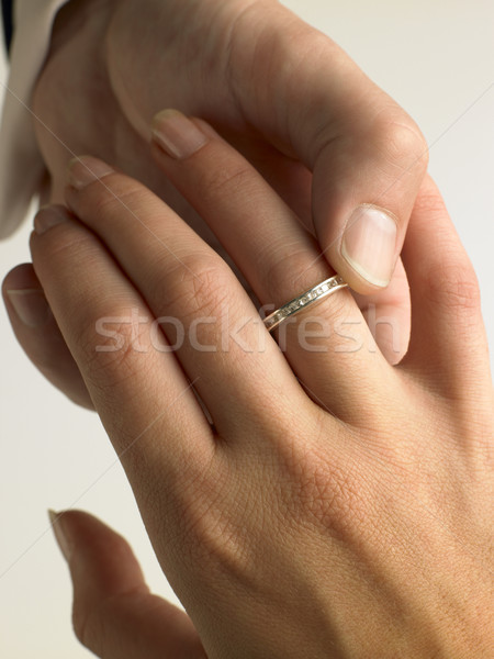 Man Putting Diamond Ring On Woman's Finger Stock photo © monkey_business