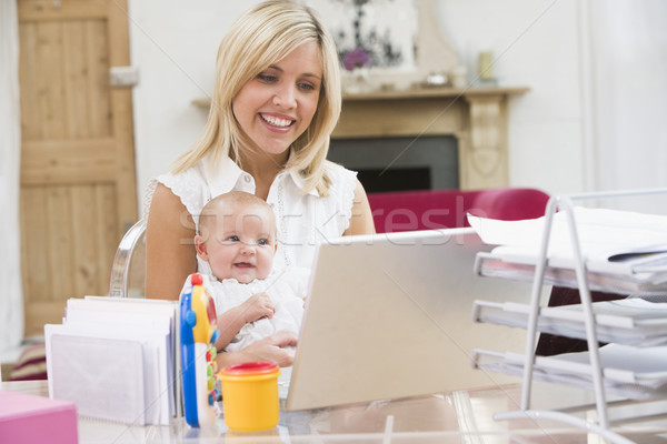 Mother and baby in home office with laptop Stock photo © monkey_business