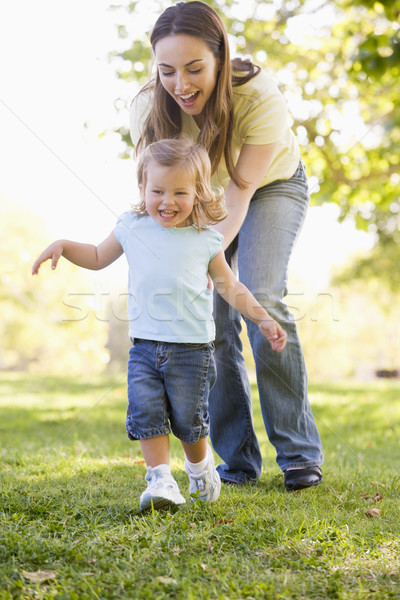 Stock photo: Mother and daughter playing outdoors smiling