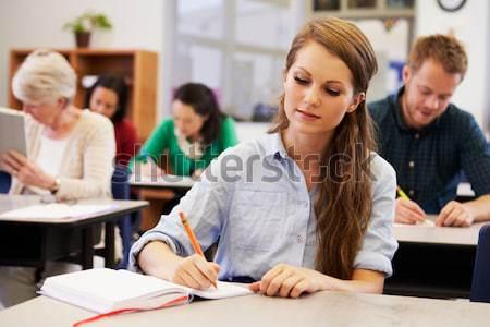 Stockfoto: Schoolkinderen · leraar · studeren · school · bibliotheek · boek