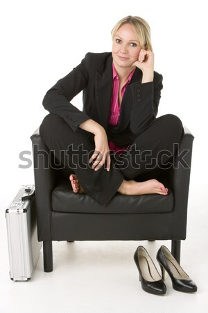 Businesswoman Sitting In Leather Chair With Her Shoes Off Stock photo © monkey_business