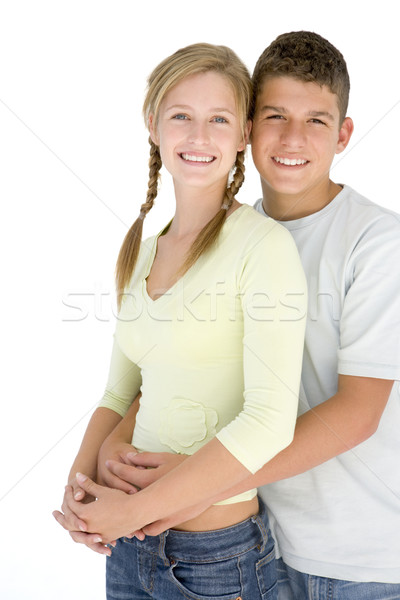 Young couple standing together smiling Stock photo © monkey_business