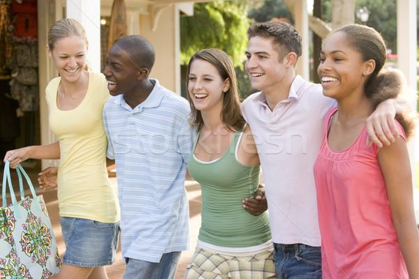 Grupo adolescentes fora compras amigos caminhada Foto stock © monkey_business