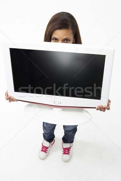 Portrait of Smiling Teenage Girl Holding Television Stock photo © monkey_business