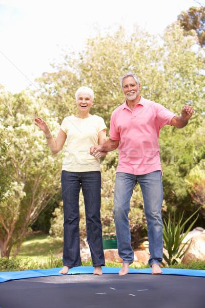 Casal de idosos saltando trampolim jardim homem pessoa Foto stock © monkey_business
