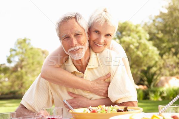 Сток-фото: еды · саду · женщину · счастливым
