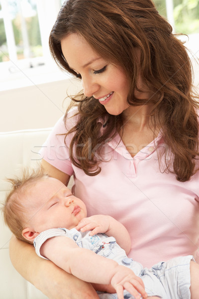 Close Up Of Affectionate Mother Cuddling Baby Boy At Home Stock photo © monkey_business