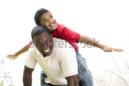 Apa fia játszik háton tengerpart boldog nyár Stock fotó © monkey_business